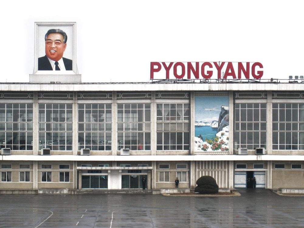 Kim Il Sung's portrait is the first thing a visitor sees stepping off the plane in North Korea.