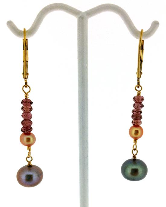 Beautiful, light colored peacock pearl dangly drop, accented with peach pearl and rhodolites (pink garnets) Gold filled lever backs.