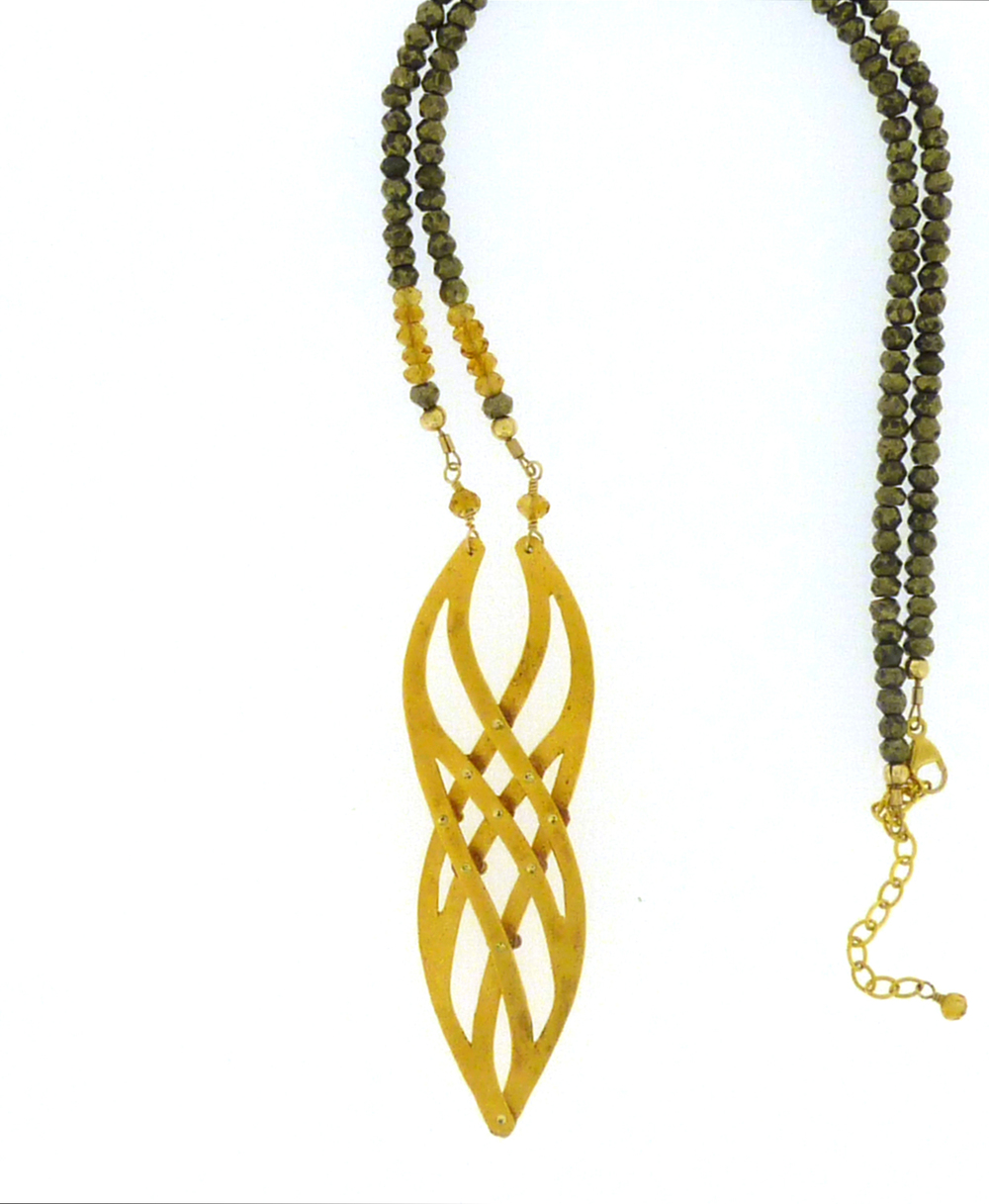 This version of the Infinity Necklace was made with two 24K Gold Vermeil pieces, accented with citrines on pyrite necklace.