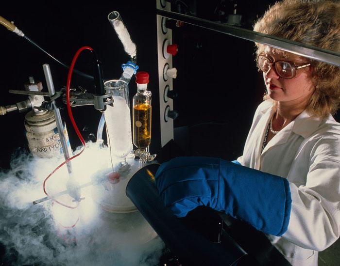 Chemist pouring liquid nitrogen