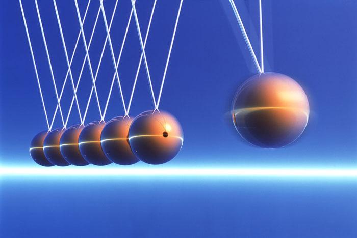Newton's Cradle in Motion