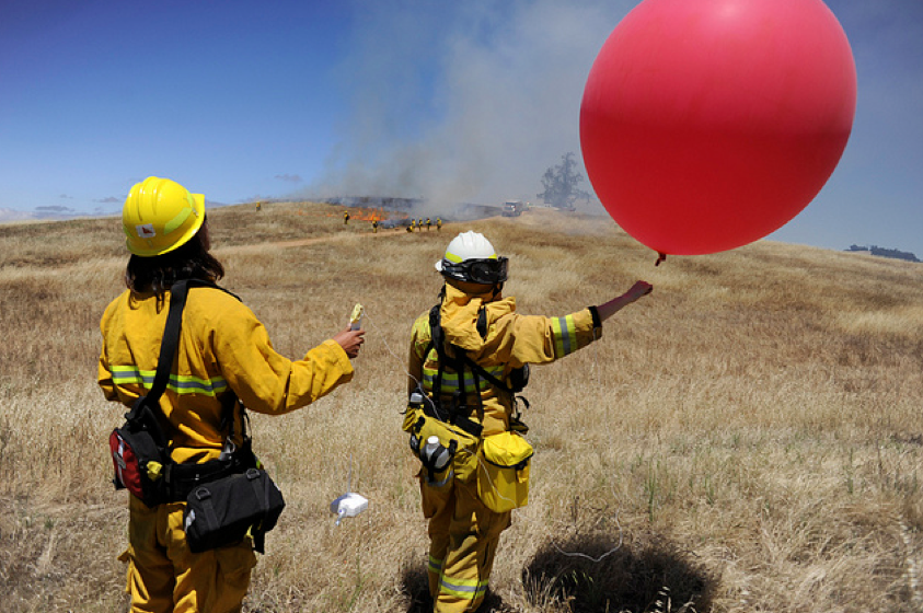 SJSU students launching radiosonde during a prescribed fire, 2012 (Neal Waters Photo).