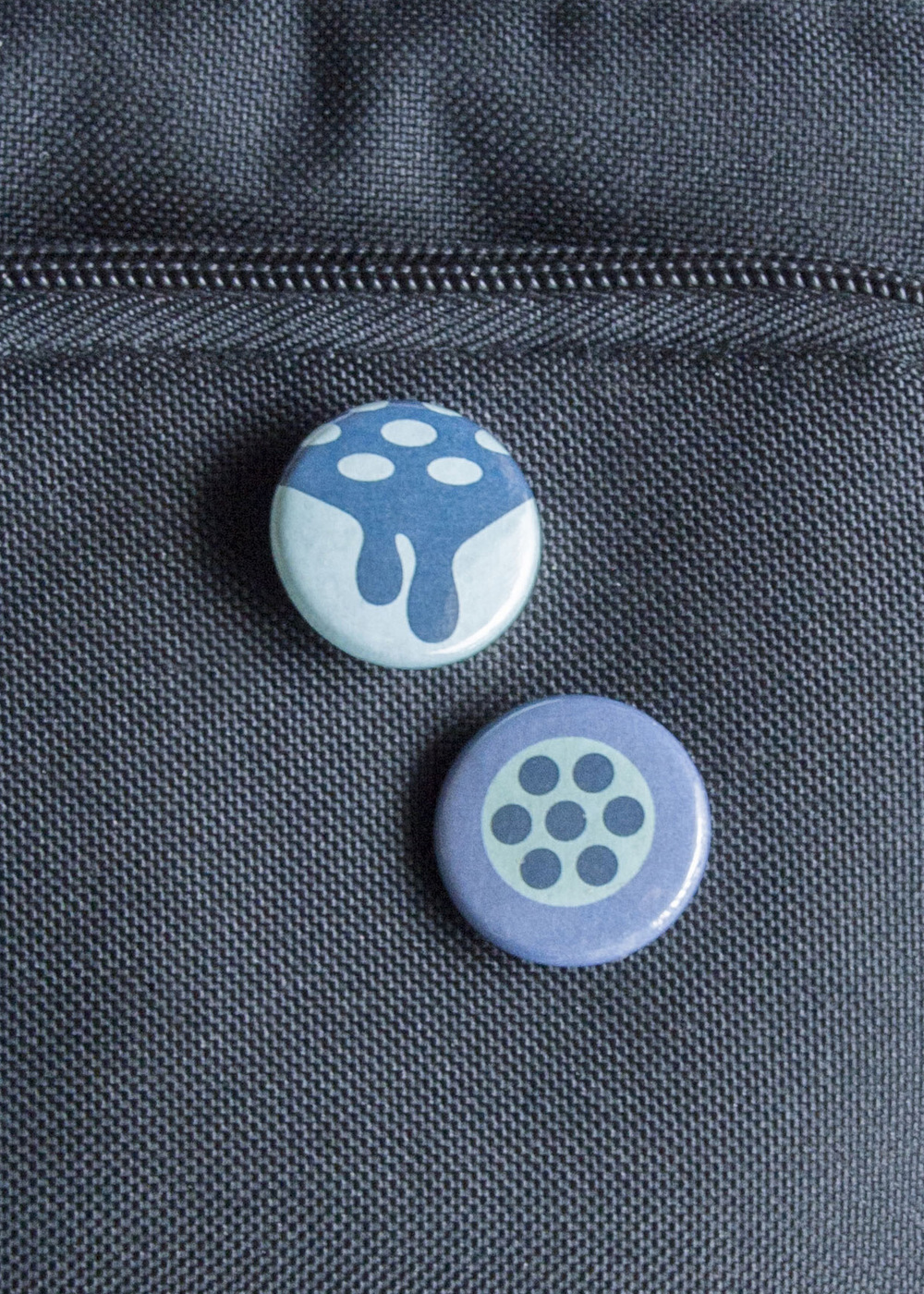 Buttons that were made and placed on a backpack