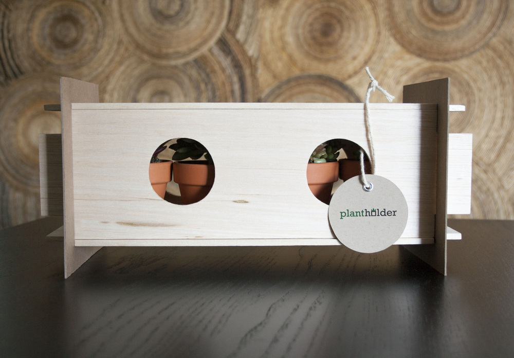Plantholder assembled with plants inside and label attached, how a customer would buy the package.