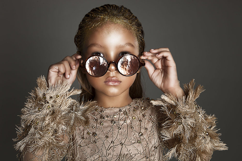 Envisioning what the new year may bring, Harper Tillman looks forward to her future in a  Mischka Aoki frock & Future Eye shades.