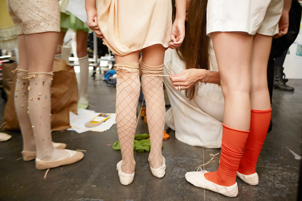 Alix Martinez  captures designer Bonnie Young tying all loose ends backstage at the second edition of petitePARADE, Kids Fashion Week.