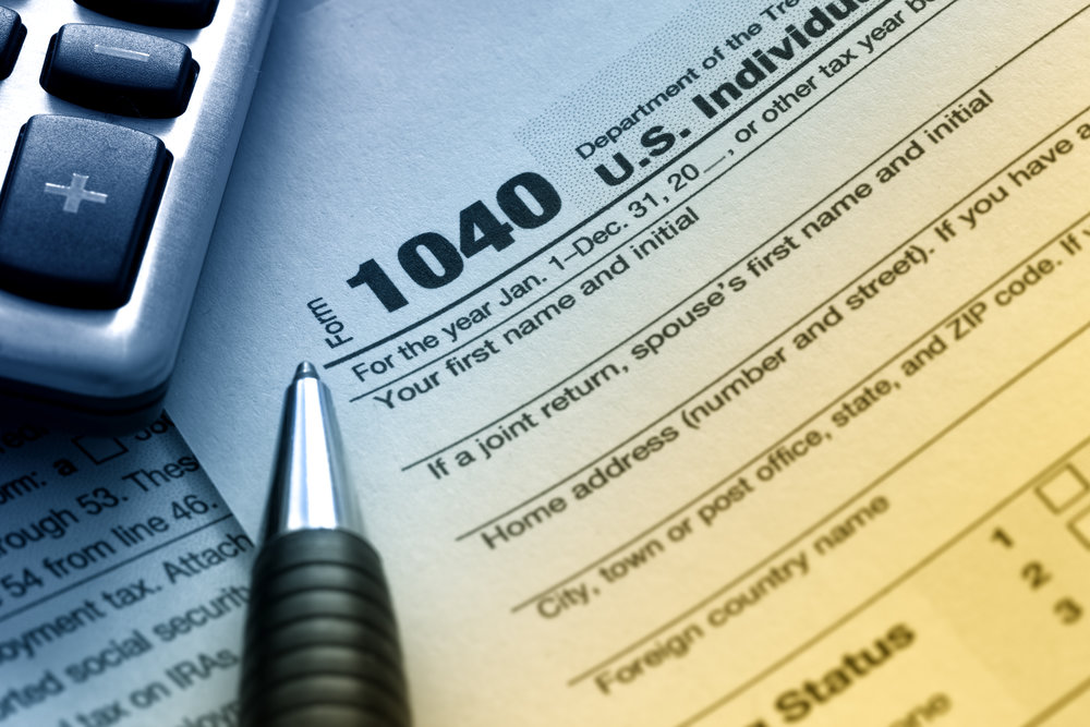 Is someone helping me proactively minimize income taxes?