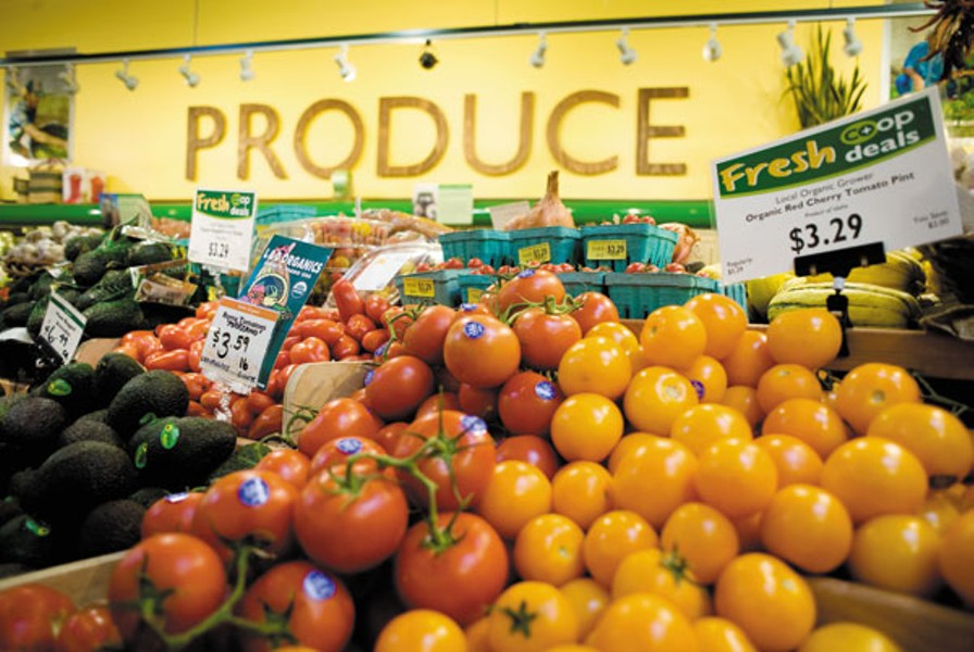 Source: Boise Weekly  Image of the produce section of a food co-op. Pictured are yellow and red tomatoes and avocados.
