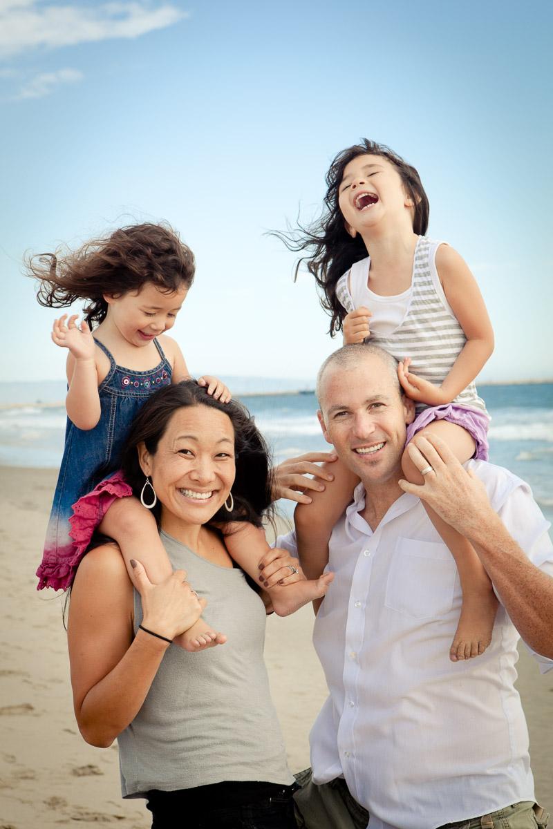 Little girls on parents shoulders