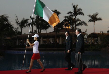 Rory McIlroy and Graeme McDowell walk behing the Irish tricolour at the World Cup in 2011.