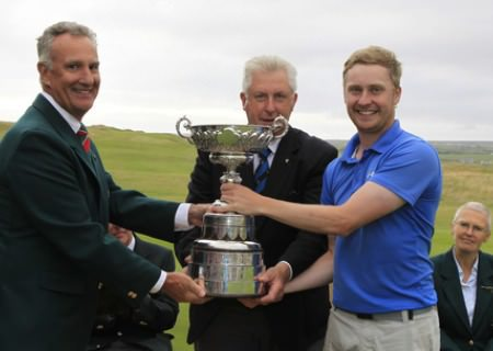 John Madden, Captain of Lahinch Golf Club, presents the South of Ireland Amateur Open trophy to County Louth's Simon Ward, 31st July 2013. Picture: Thos Caffrey / www.golffile.ie