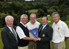 Kevin McIntyre (Chairman, Leinster Golf) presenting Paschal Taggart (Castle Golf Club) with the Chartis Insurance sponsored 2012 Senior Cup pennant (Leinster Section) after their victory over Portmarnock at Hermitage Golf Club (19/08/2012). Also in the picture are Fintan Buckley (President, Golfing Union of Ireland) and joint team managers Harry Gleeson (centre) and Jim Pender. Picture by Pat Cashman