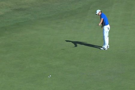 Rory McIlroy rolls home the winning putt.