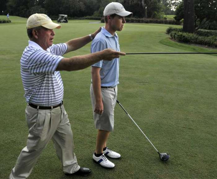 Kevin Phelan and his coach Mark McCumber working at TPC Sawgrass.