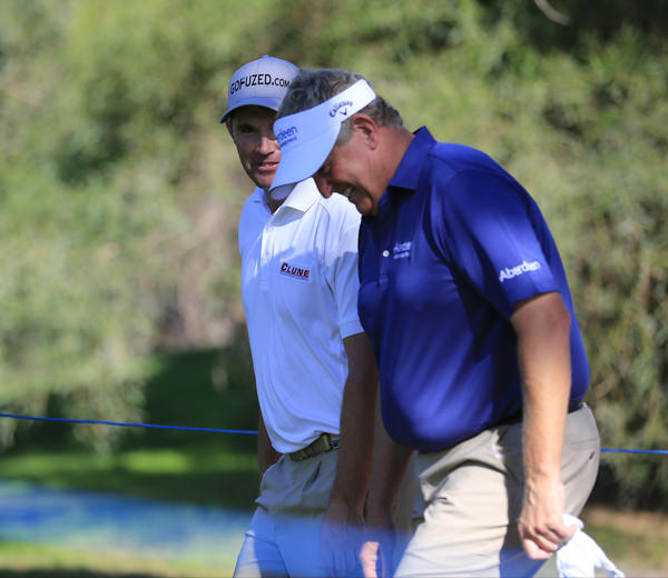 Pádraig Harrington shares a joke with his former Ryder Cup partner Colin Montgomerie during his final event of 2013, the Turkish Airlines Open. Picture: Fran Caffrey www.golffile.ie