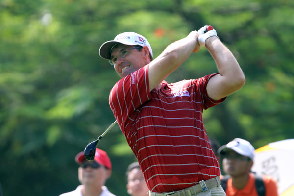 Sporting spectacles, Pádraig Harrington tees off the delayed second round of the Maybank Malaysian Open in March. Photo Jenny Matthews/www.golffile.ie