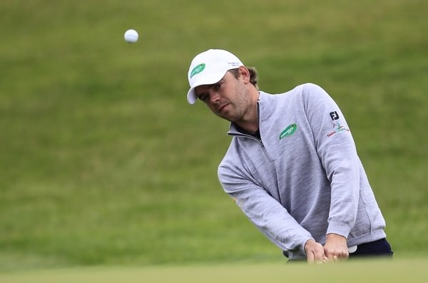 Gareth Shaw plays a pitch during the final round of the 2013 Irish Open at Carton House.Picture: Thos Caffrey / www.golffile.ie