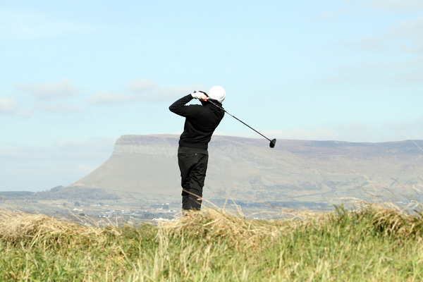 Faithlegg's Robin Dawson tees off on the 10th in the quarter-finals of the 2013 West of Ireland Championship at Co Sligo, Rosses Point. Picture:Jenny Matthews / www.golffile.ie