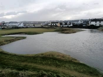 Flooding near the third tee at Lahinch. The second green is not under water but the third tee was inaccessible.