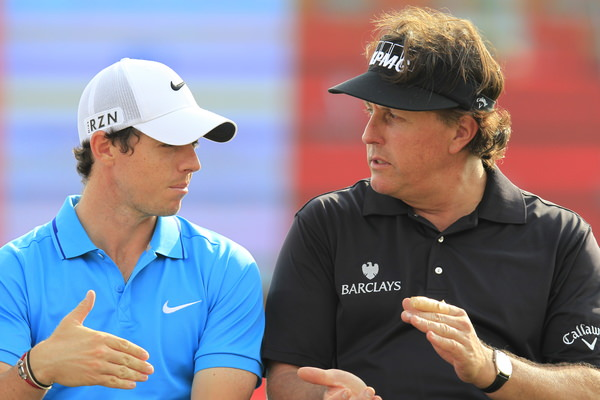 Abu Dhabi runner-up finishers Rory McIlroy and Phil Mickelson chat at the prize-giving ceremony. Picture: Eoin Clarke www.golffile.ie