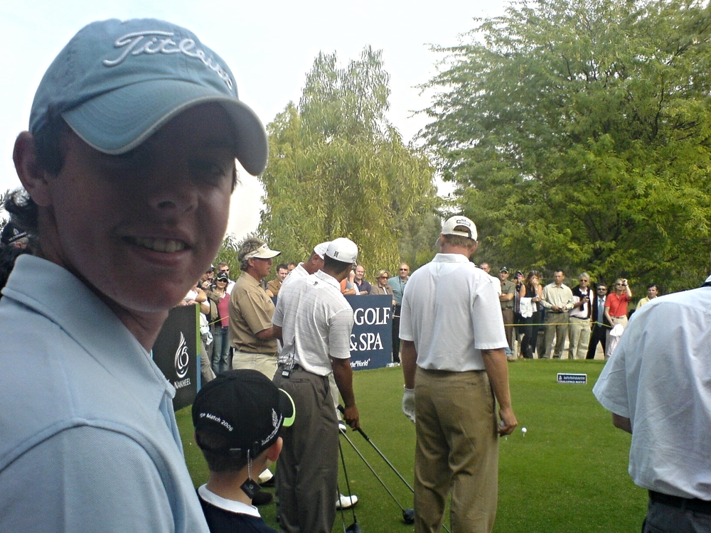 Rory McIlroy watches Tiger Woods, Thomas Bjorn, Darren Clarke and Ernie Els play an exhibition match at Jumeirah in Dubai in 2006. Picture © Brian Keogh / irishgolfdesk.com