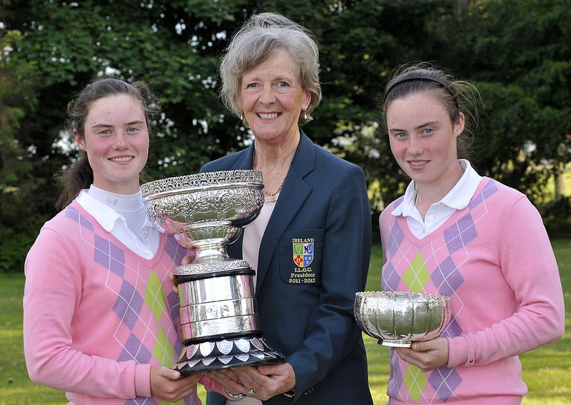 Marjorie McCorduck (President, ILGU) presents Leona Maguire (Slieve Russell) with the 2012 Irish Women's Close Amateur Championship. Also pictured, leading qualifier Lisa Maguire (Slieve Russsell). Picture by Pat Cashman cashmanphotography.ie