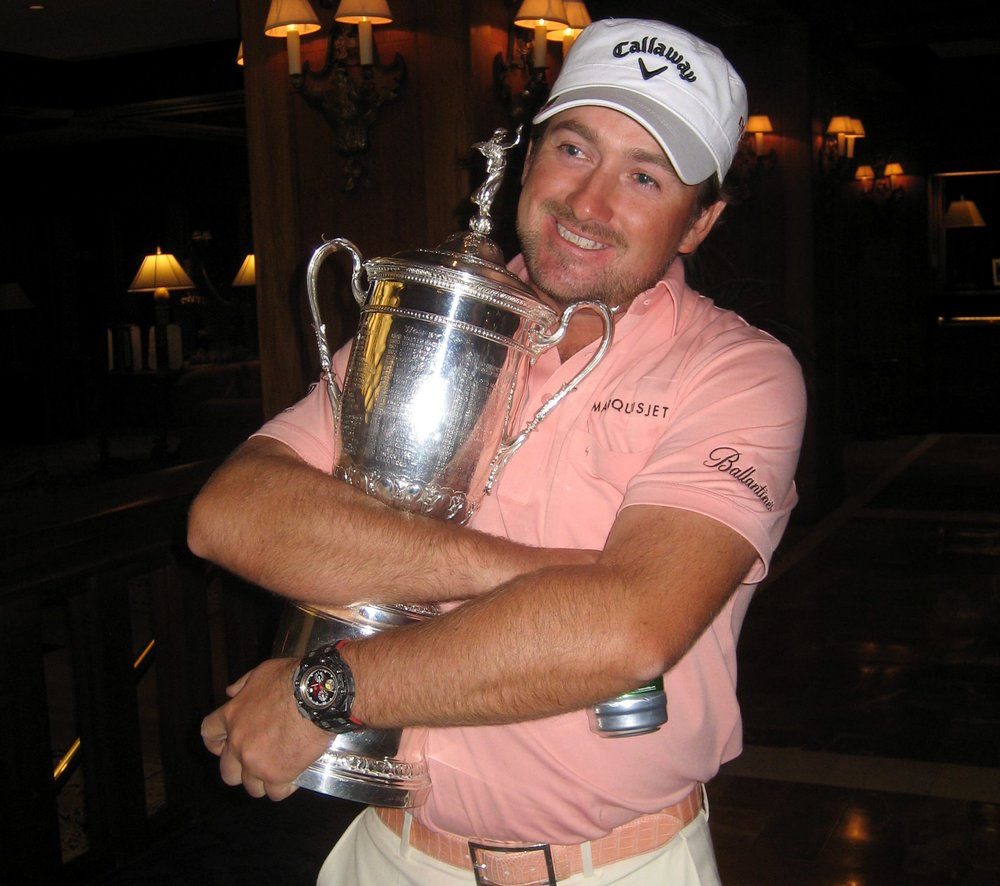 Graeme McDowell cradles the US Open trophy — and a beer — on his return to his hotel in 2010. Picture © Brian Keogh