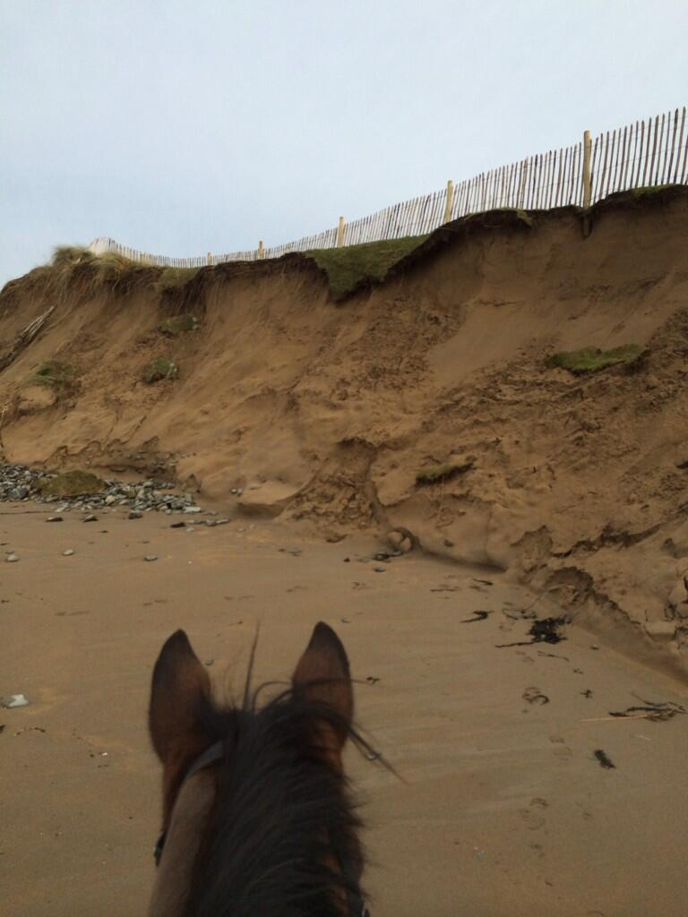 A photo of recent storm damage at Doonbeg. Via  @FinbarKeating