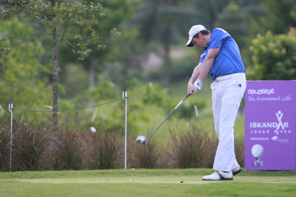 Happier times. Niall Turner tees off in 2011 Iskandar Johor Open in Malaysia. Photo Eoin Clarke/ www.golffile.ie