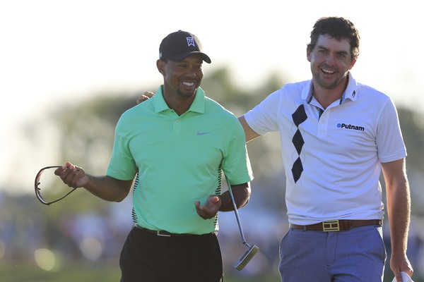 Tiger Woods and Keegan Bradley share a joke at the 18th. Picture: Fran Caffrey www.golffile.ie