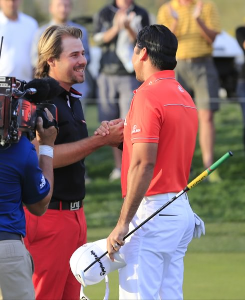 Jason Day is congratulated by Victor Dubuisson in Tucson. Picture: Fran Caffrey  www.golffile.ie