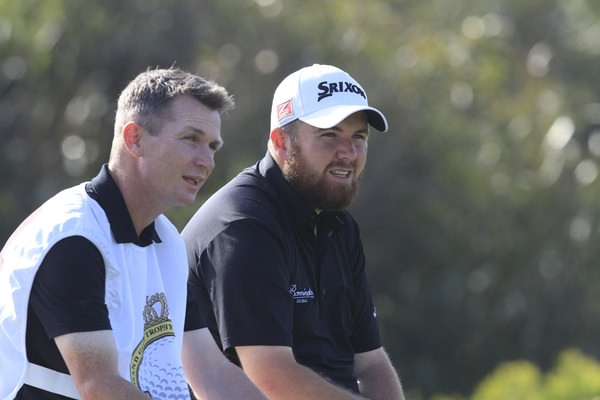 Shane Lowry and his caddie Dermot Byrne take a breather. Picture: Thos Caffrey /  www.golffile.ie
