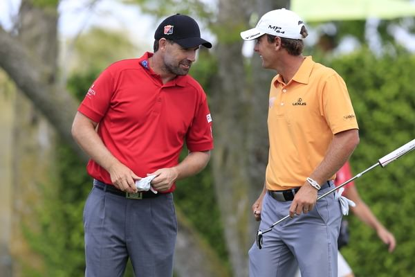 Pádraig Harrington enjoys some banter with Charles Howell III at Bay Hill on Saturday. Picture: Fran Caffrey  www.golffile.ie