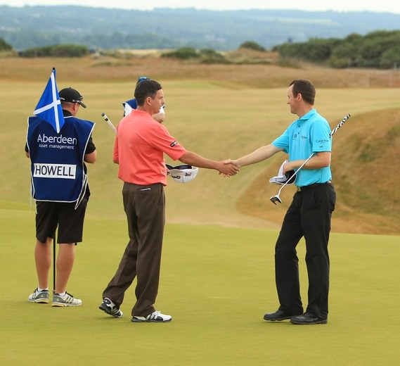 Peter Lawrie and Michael Hoey shake hands after a round in the Scottish Open last year. Picture Stuart Adams  www.golffile.ie