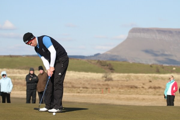 Headfort's Rory McNamara holes the winning putt in last year's Radisson Blu sponsored West of Ireland Amateur Open at Co Sligo GC, Rosses Point. Photo Jenny Matthews/ www.golffile.ie