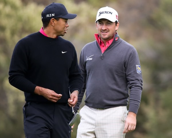 Graeme McDowell and Tiger Woods at last year's World Challenge in Los Angeles. Photo: Kenneth E Dennis /  www.golffile.ie