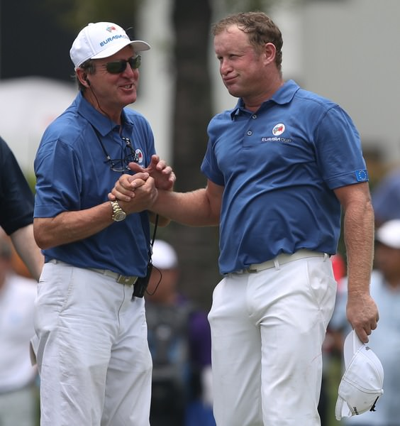 Team Europe Vice-Captain Des Smyth  shakes the hand of a relieved Jamie Donaldson at the Glenmarie Golf & Country Club, Kuala Lumpur, Malaysia. Picture: David Lloyd /  www.golffile.ie