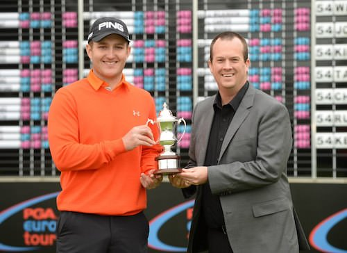 David Booth receives his trophy from EuroPro Director of Operations Daniel Godding. Picture www.europrotour,com