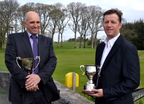 Tony Cleary (left) and Alan Neville with their 2014 Mid West Alliance trophies.