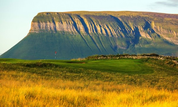 Ben Bulben stands watch over County Sligo Golf Club, Rosses Point. Picture via countysligogolfclub.ie