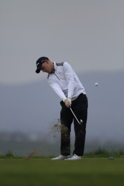 Geoff Lenehan strikes another crisp iron shot. Picture: Thos Caffrey / www.golffile.ie