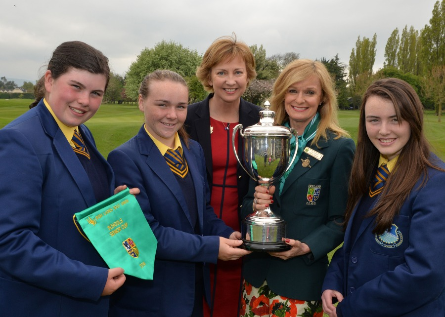 Liz Carton (Chairperson, Eastern District, ILGU) presenting Niamh Ward (St Michael's Grammar School, Lurgan) with the Senior Cup after their victory at the 2014 Irish Schools Senior & Junior Cup Finals at Milltown, 28th April). Also in the picture are (from left) Niamh McSherry, Aisling O'Grady (Lady Captain, Milltown Golf Club) and Eadaoin Ward. Picture by Pat Cashman  cashmanphotpgraphy.ie