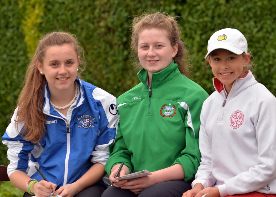 Checking score cards are (from left) Katie Keenan (Loreto Kilkenny), Emma Hooban (Scoil Chroist Ri Portlaoise) and Georgia Carr (Alexandra College Dublin) at the 2014 Irish Schools Senior & Junior Cup Finals at Milltown Golf Club today (Monday 28th April). Picture by Pat Cashman  cashmanphotpgraphy.ie