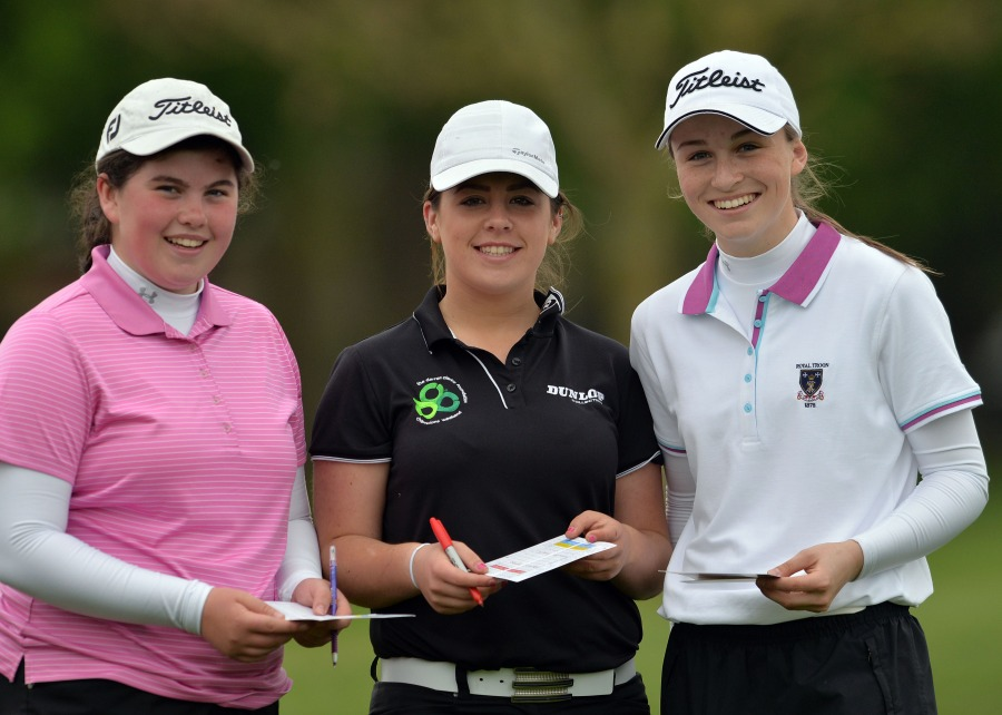 (From left) Niamh McSherry (St Michael's Lurgan), Mary Doyle (Scoil Chriost Ri Portlaoise) and Julie McCarthy (Santa Sabina Dublin) check their cards at Milltown. Picture by Pat Cashman cashmanphotpgraphy.ie