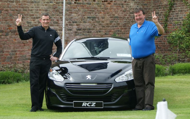 Woodbrook's Paul O'Farrell (left) and Greystones' Dermot Whitson celebrate winning cars for a hole-in-one at Greystones.