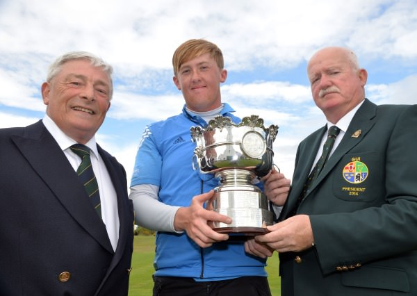 Liam Martin (President, Golfing Union of Ireland) presenting Jamie Savage (Scotland) with the Irish Amateur Open Golf Championship trophy after his victory at The Royal Dublin Golf Club today (11/05/2014). Also in the picture is Enda McDermott (Captain, The Royal Dublin Golf Club). Picture by Pat Cashman  cashmanphotography.ie