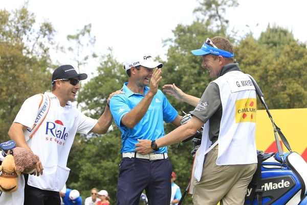 It's in. Gareth Maybin celebrates with his caddie. Picture: Thos Caffrey /  www.golffile.ie