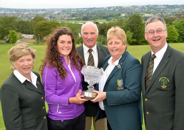 Mary McKenna  (President, Irish Ladies Golf Union) presenting Lucy Goddard (England) with the 2014 Irish Women's Open Strokeplay Championship trophy after her victory at Douglas Golf Club today (Sunday 25th May).Also in the picture (from left) Bernie Watson (Lady Captain, Douglas Golf Club), Bill O'Connell (President, Douglas Golf Club) and Dermot McHugh (Captain, Douglas Golf Club). Picture: Pat Cashman  cashmanphotography.ie