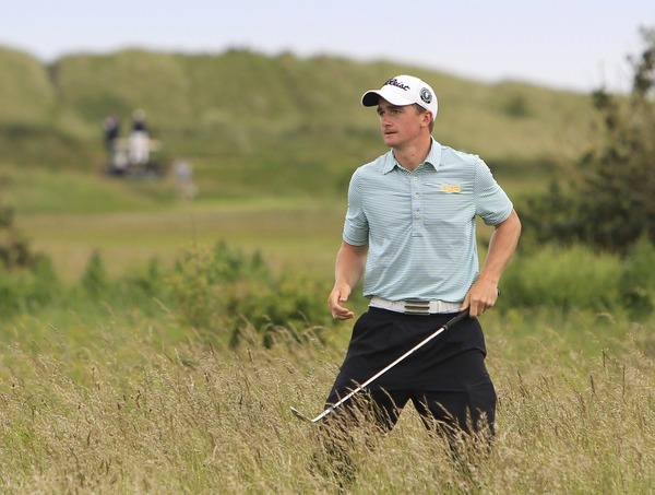 Paul Dunne tangles with the rough at the first.  Picture: Thos Caffrey /  www.golffile.ie