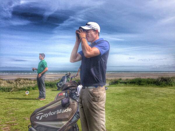 Tullamore's Stuart Grehan checks his yardage on the 17th tee.